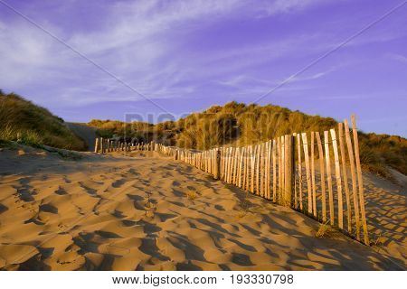Wooden dune fence on Camber Sands beach, East Sussex, England