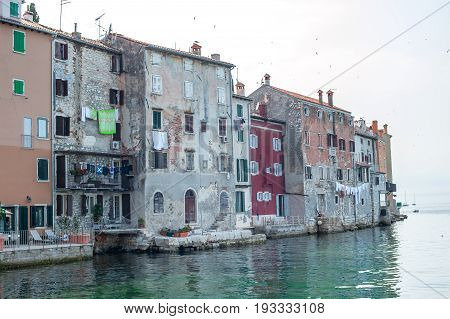 Historical Houses Facing Mediterranean Sea. Oldest Part Of Rovinj Town