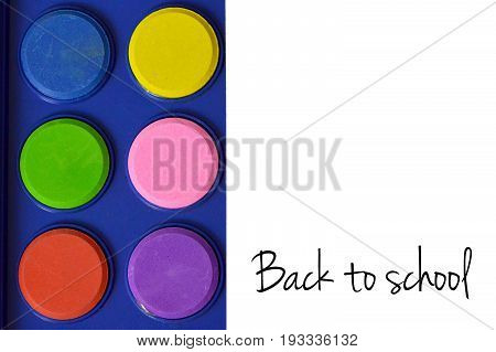 Back to school text and unused watercolors