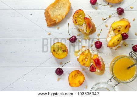 Homemade Fresh Sweet Toasted Toast With Fruit. Peach And Cherry Sandwiches With Nuts And Honey On A