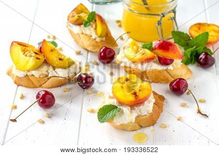 Homemade Fresh Sweet Toasted Toast With Fruit. Peach And Cherry Sandwiches With Nuts And Honey On Th