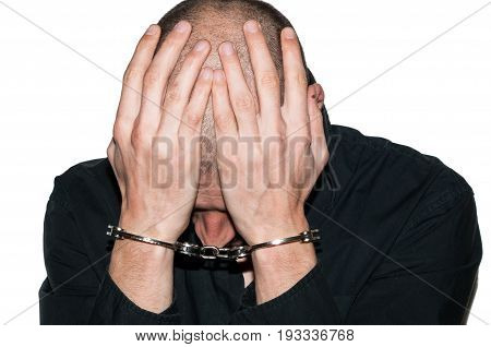 Arrested criminal. Arrested criminal with handcuffs on his hands. Crime concept.