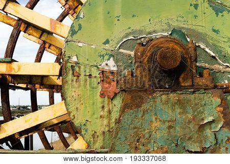 A boat rusts in the boatyard long ago abandoned