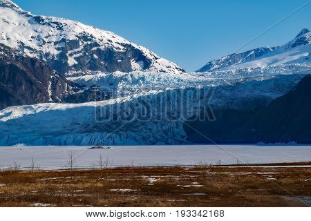 Mendenhall Glacier flowing down at Alaska's Inside Passage