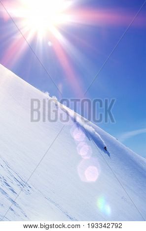 High angle view of skier skiing on mountain slope