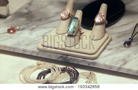 Marble background with fashionable jewelry for sale at store