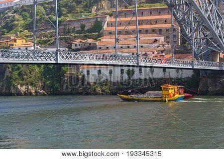 PORTO, PORTUGAL - APRIL 17, 2017: Boat at the Ribeira in the Douro River bank near the Dom Luis I Bridge, Porto, Portugal.