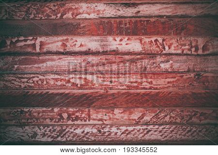Red wood texture in vintage style. Red wooden abstract background. Abstract texture and background for designers. Closeup view of red vintage wood. Red wood background.