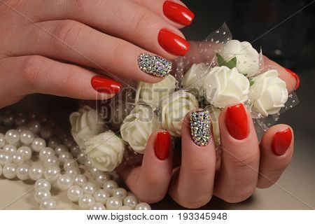 Red Manicure Design With Ornaments