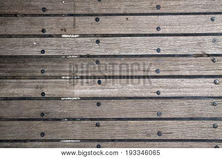 Wooden plank floor with between floorboards rubber - Image for background.
