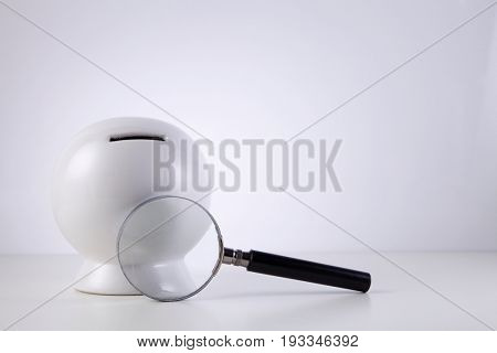 coin box with magnifier on the white background