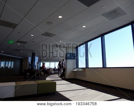 SEATTLE-- JUNE 25: People look at view from the Sky View Observatory - Columbia Center the highest point in Seattle on June 25 2016 in Seattle WA.