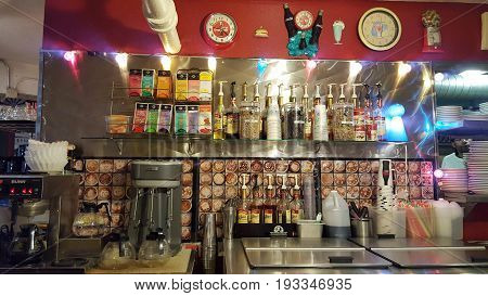 SEATTLE - JUNE 25 2016: Coffee tea and Drink station inside Planet Java Diner kitchen featuring photos and clocks on the wall.