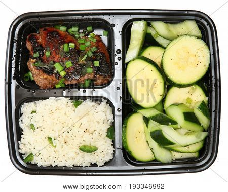 Bento Box Soy-Marinated Chicken Thigh with Jalapeno Jasmine Rice and Marinated Vegetables.
