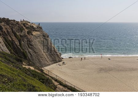 Malibu, California, USA - June 29, 2017:  View of rock climbing cliff at Westward Beach in Point Dume State Park.