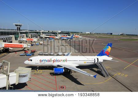Amsterdam The Netherlands - May 26th 2017: D-ABDB Small Planet Airlines Germany Airbus A320 at the gate at Schiphol International Airport