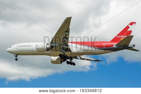 SHEREMETYEVO MOSCOW REGION RUSSIA - June 28 2017: Boeing 777-200 of Nordwind Airlines makes a landing at Sheremetyevo International Airport.