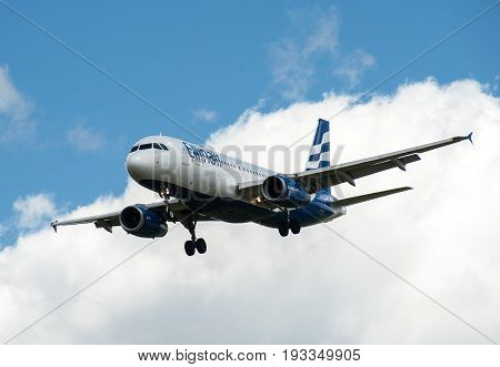 SHEREMETYEVO MOSCOW REGION RUSSIA - June 28 2017: Airbus A320-200 of Ellinair Airlines makes a landing at Sheremetyevo International Airport.