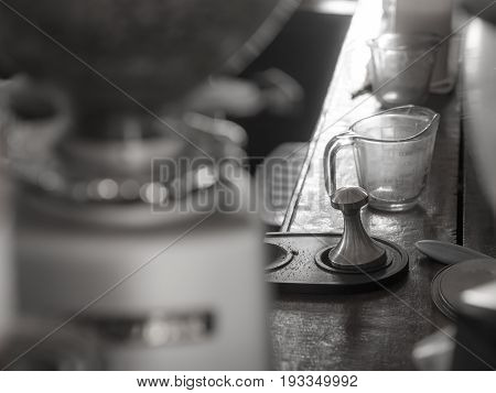 Black And White Picture Of Coffee Tamper, In A Cafe.