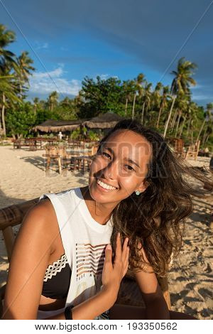 EL NIDO, PALAWAN, PHILIPPINES - MARCH 29, 2017: Portrait of mixed race woman smilling atLas Cabanas Beach.