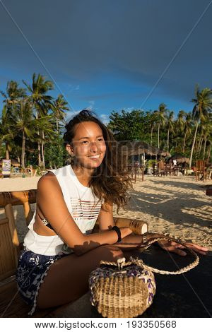 EL NIDO, PALAWAN, PHILIPPINES - MARCH 29, 2017: Smile of mixed race asian blood with south america blood at Las Cabanas Beach.