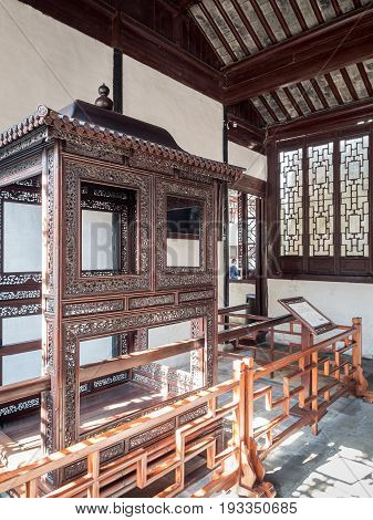 Suzhou, China - Nov 5, 2016: A historic palanquin on display at the Master of Nets Garden (Wang Shi Yuan); near the entrance.