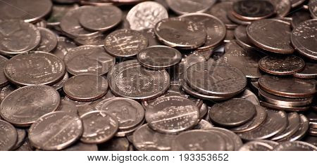 A pile of US nickels, dimes and quarters