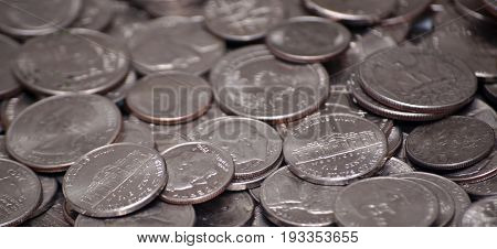 US nickels, dimes and quarters in a pile