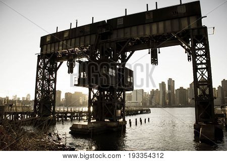 The back of iconic gantries of Gantry State Park and river in old vintage style