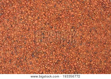 Red laterite gravel texture for use as background.