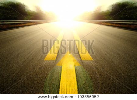 Road With Painted Yellow arrow Line, forward to fast future.