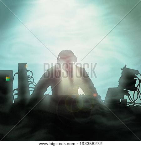 An electronic keyboardist or DJ with light goggles performing on a smoky stage.