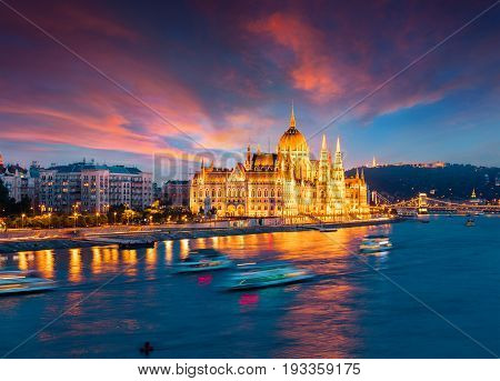 Colorful Evening View Of Parliament And Chain Bridge