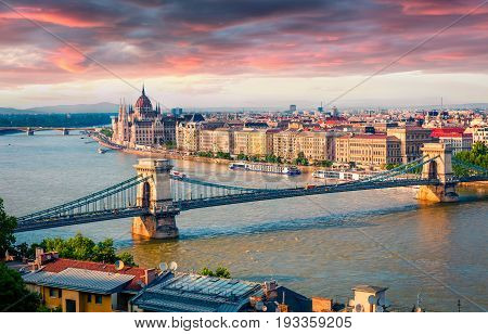 Colorful Cityscape Of Hungarian Parliament Building With Famous Chain Bridge On The Danube River.