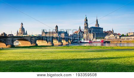 morning view of Cathedral of the Holy Trinity or Hofkirche Bruehl's Terrace or The Balcony of Europe. Colorful spring scene on Elbe river in Dresden Saxony Germany Europe.