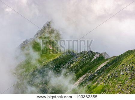 Steep Slope On Rocky Hillside In Fog