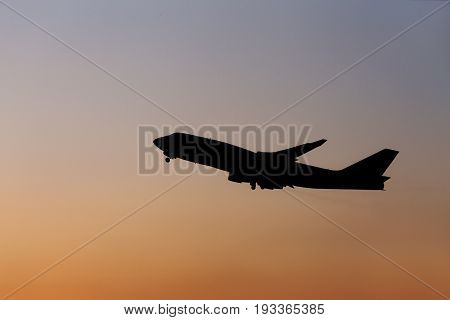 Silhouette airplane in the sunset sky. transportation concept.