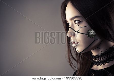 luxurious cyberpunk girl with fashion makeup isolated on gray background