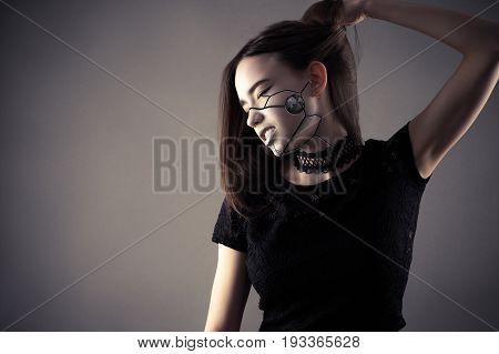 fashionable cyberpunk girl holding hair in hand