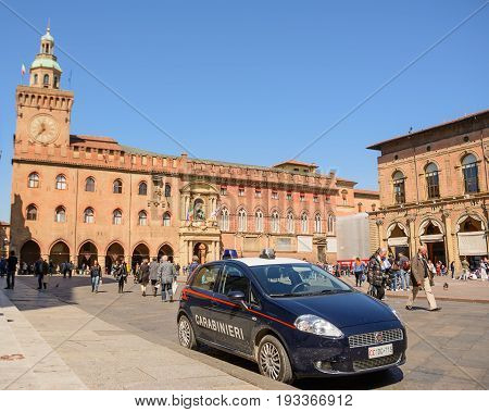 Bologna Italy - April 22 2017: Police car in Piazza Maggiore of Bologna with tourists