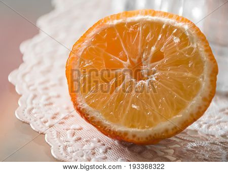 Close-up and isolated orange fruit slice on table withe tablecloth