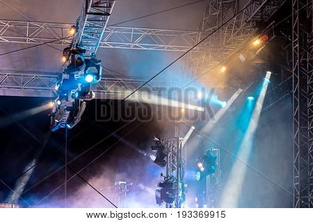 Concert Lighting On Stage. Lighting Equipment With Multicolored Beams.