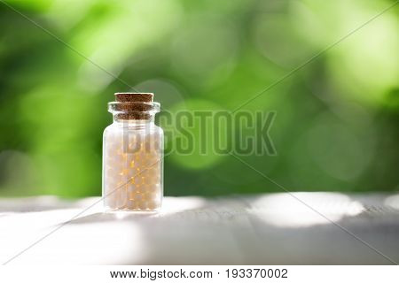 Homeopathy - A homeopathy concept with homeopathic medicine pills