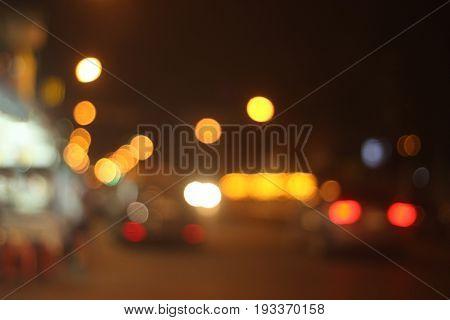 Blurred and defocused multicolored bokeh lights of night street.