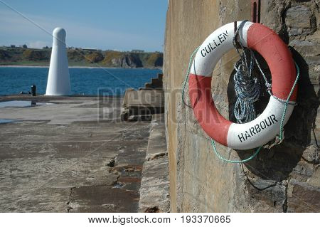 Cullen Harbour - Life ring with view out along harbour