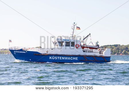 KIEL / GERMANY - JUNE 20 2017: coastguard ship from german police drives in sea water on public event Kieler Woche.