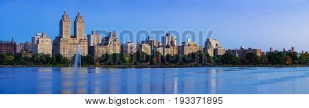 Panoramic view of Central Park West and the Jacqueline Kennedy Onassis Reservoir at dawn. Upper West Side Manhattan New York City