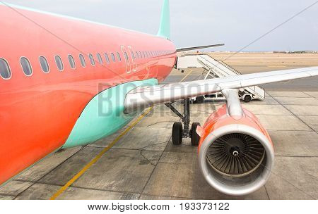 Airplane being preparing ready for takeoff in international airport at cloudy day - Travel around the world.