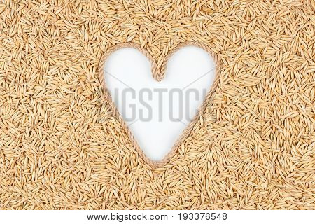 Oat grains and a rope in the shape of a heart with a place for designers. The concept of love of oat