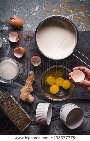 Cooking Catalan cream  on the stone background top view vertical